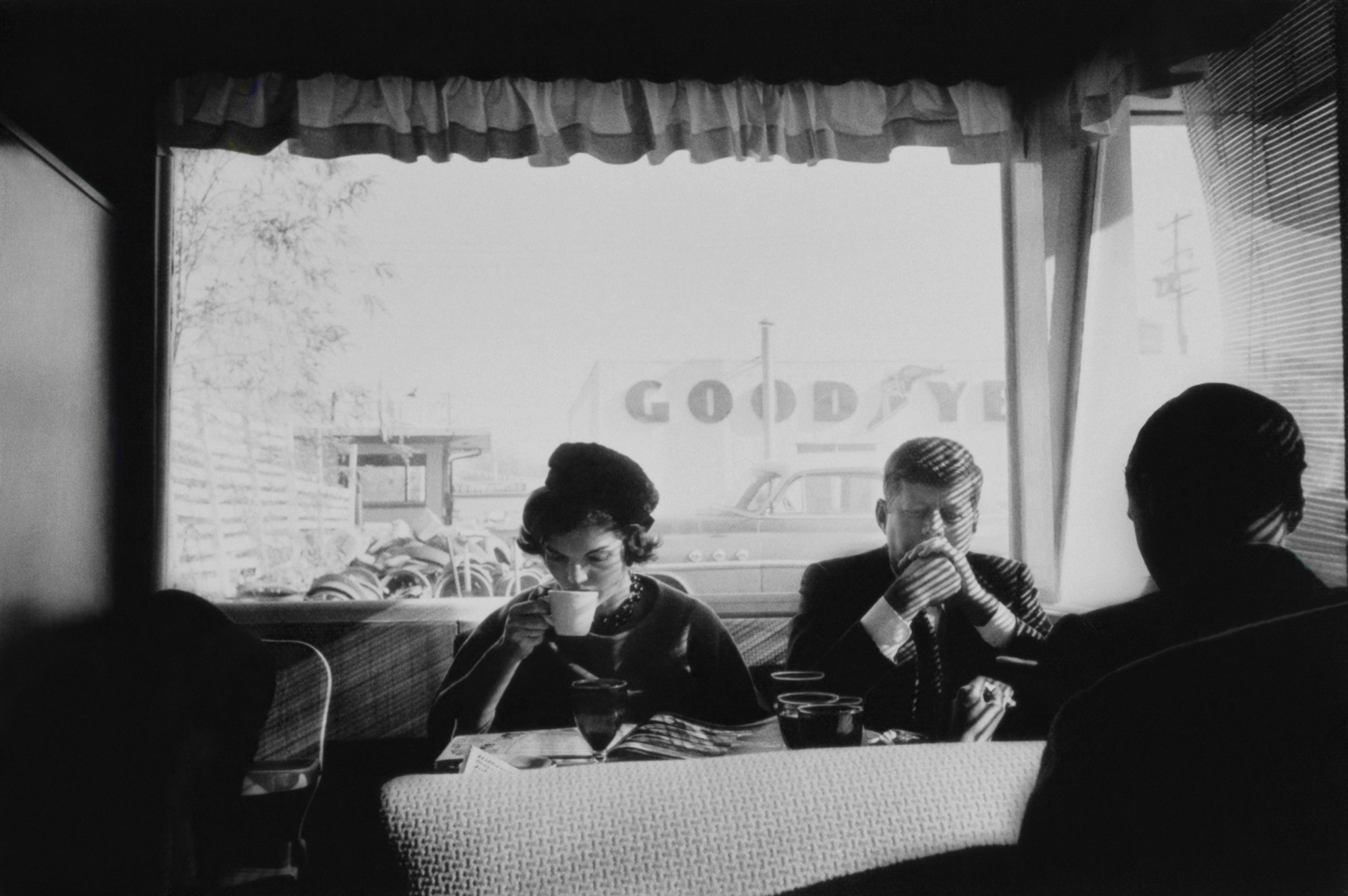 John and Jackie Kennedy sitting at restaurant -- John and Jacqueline Kennedy sit unrecognized in an Oregon diner during an early presidential campaign stop in the fall of 1959. Photo Credit: Estate of Jacques Lowe